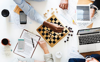 Image of Employees playing a game of Chess.