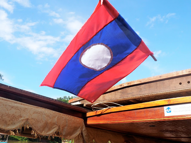 Mekong River boat with flag, Laos