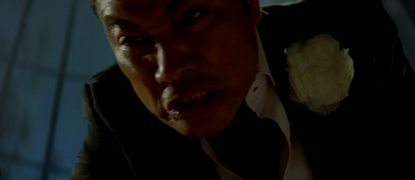 The ridiculous Simon Yam as Boss Fay in Exiled.