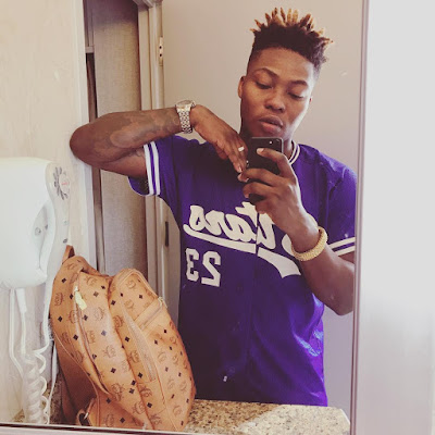 "wp 1504207091584 - ENTERTAINMENT: Reekado Banks Friend Tags Him ""Stupid"" For Tapping His Girlfriend's Bossom"