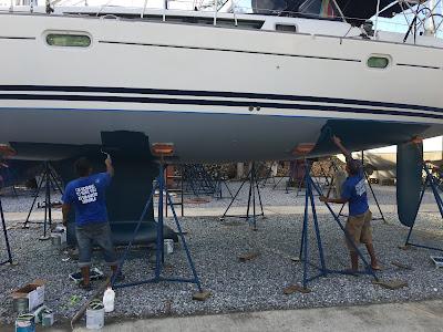 Applying International Micron anti fouling paint to yacht