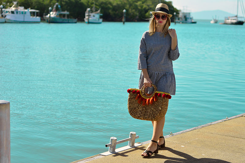 summer vacation outfit gingham dress wicker basket bag with pom poms straw hat