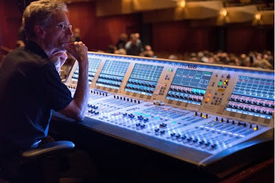 person in front of audio mixer