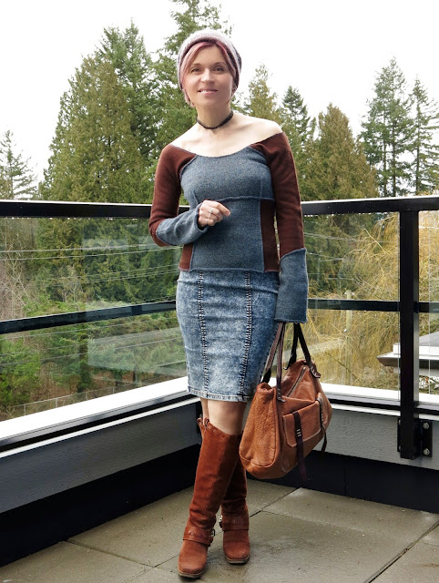 styling an acid-wash denim pencil skirt with an off-the-shoulder sweater, block-heeled booties, and a woolen beanie