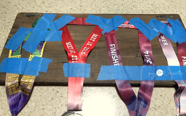 painters tape works to hang ironman medals