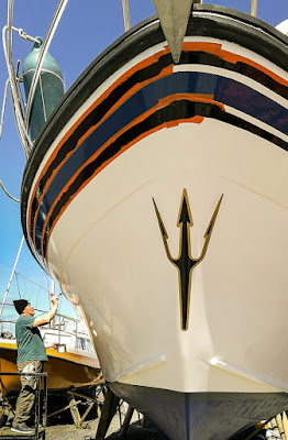 Photo of painting the black stripes around the top of the hull