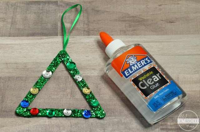 glue sequins or pom poms on the Popsicle stick Christmas tree ornament