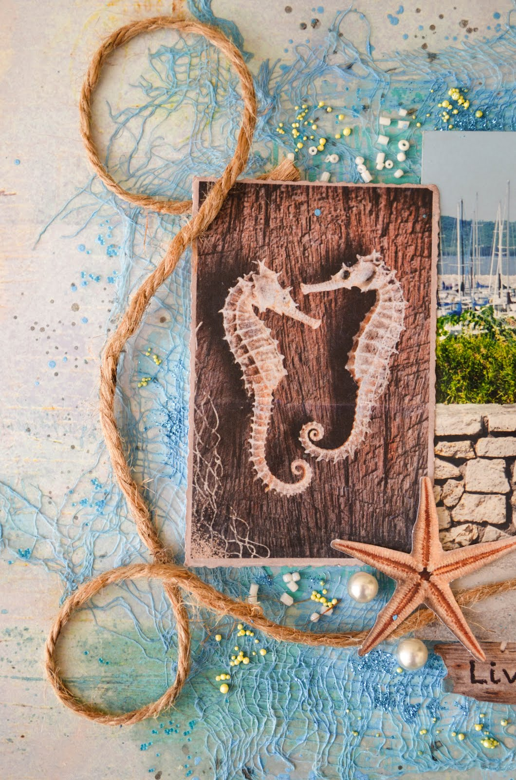 Seahorses nautical theme mixed media scrapbook page layout in blue with die cuts, cheesecloth, jute, seed beads, micro beads, and pearls