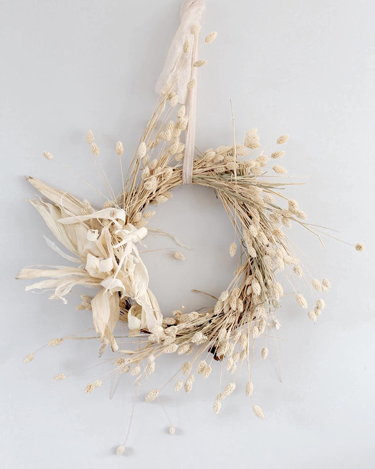 Natural white wreath with dried plants for simple Christmas decoration by floretally