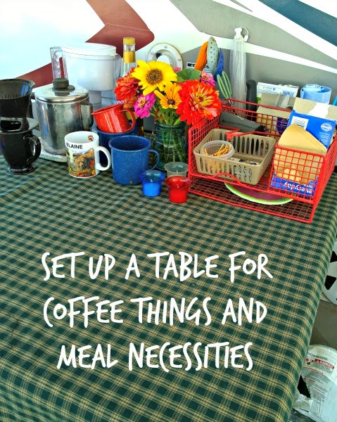 folding table set up for coffee and food stuff outside of rv,Must Do Camping Hacks, camping tips and tricks, travel, rv, travel trailer organization