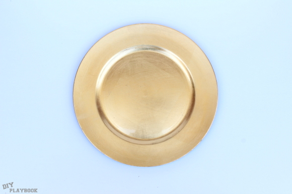 This DIY gold decorative plate will add a fancy touch to a dinner table