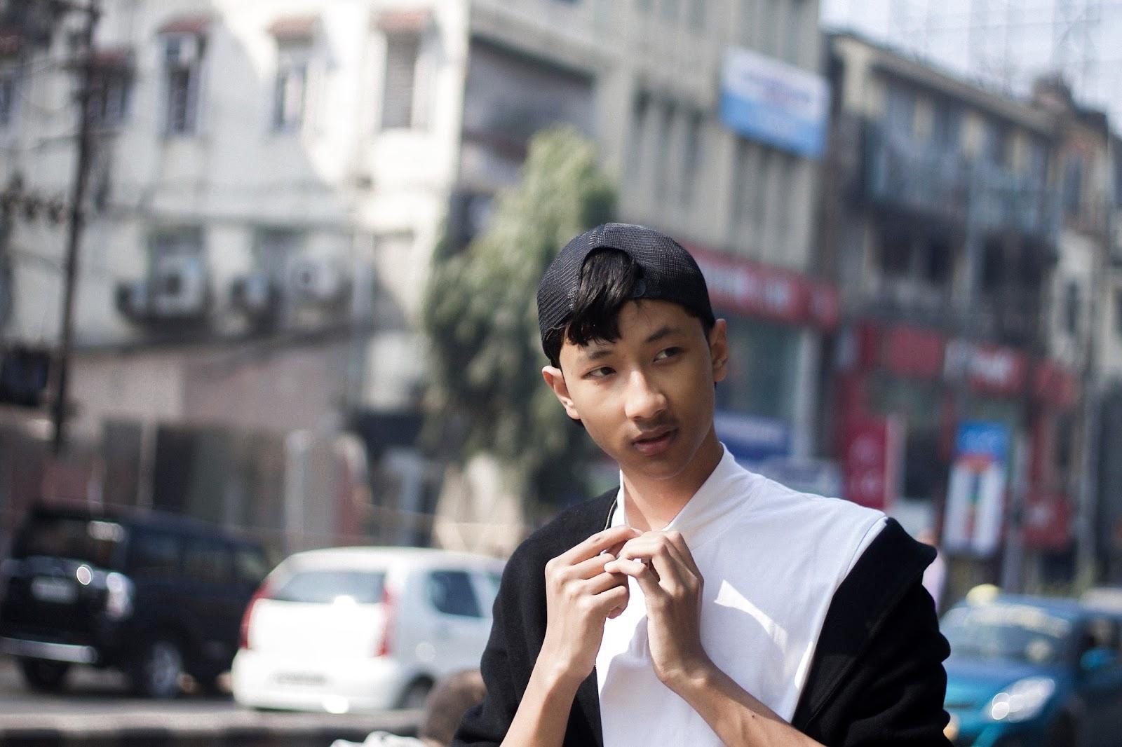 TheQuirkyMinimal by Kangkan Rabha Indian Menswear fashion blog Wearing Koovs Tee, Trouser, & Shoes, No brand black Jacket & Cap