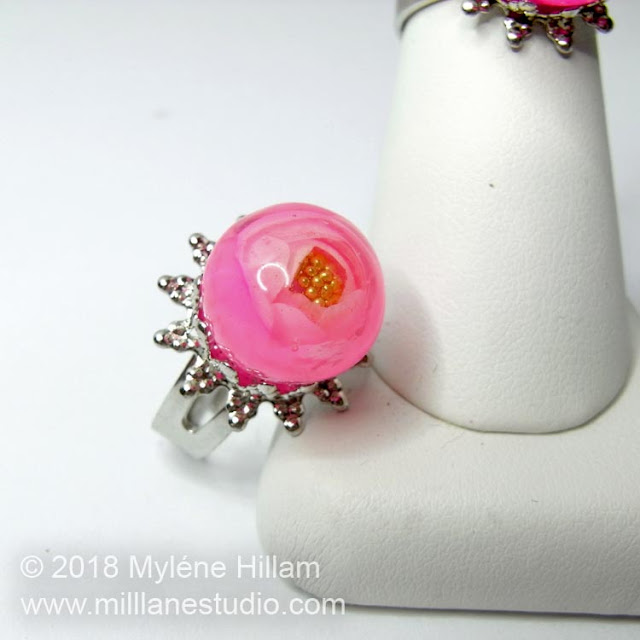 Pastel Pink UV resin rose bead with gold bead caviar centre, set in a silver filigree ring.