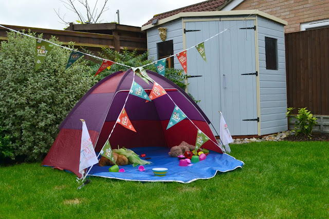 A tent an bunting in garden