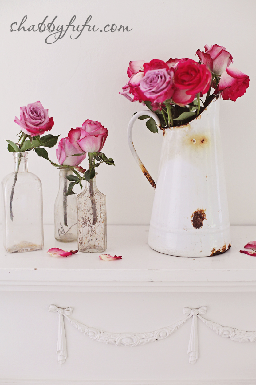 five minute design tips - pops of pink roses in crystal jars and an aged water vase