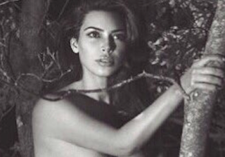Kim Kardashian Poses In Nothing But Boots