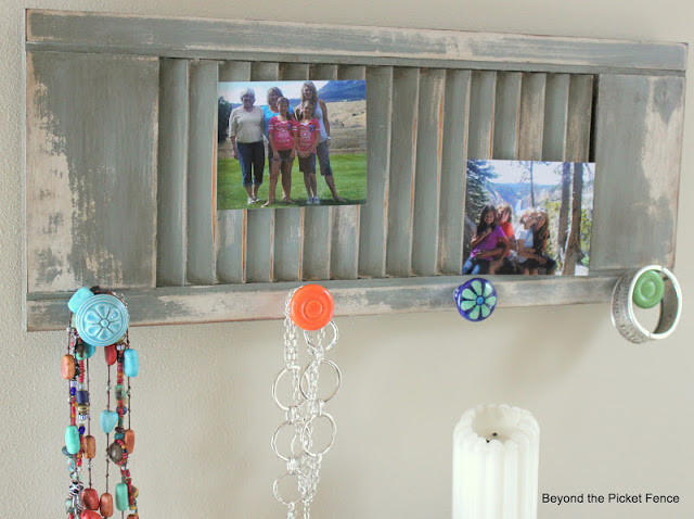 Transform an old shutter into a photo display