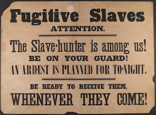 A notice regarding the presence of a slave-hunter.