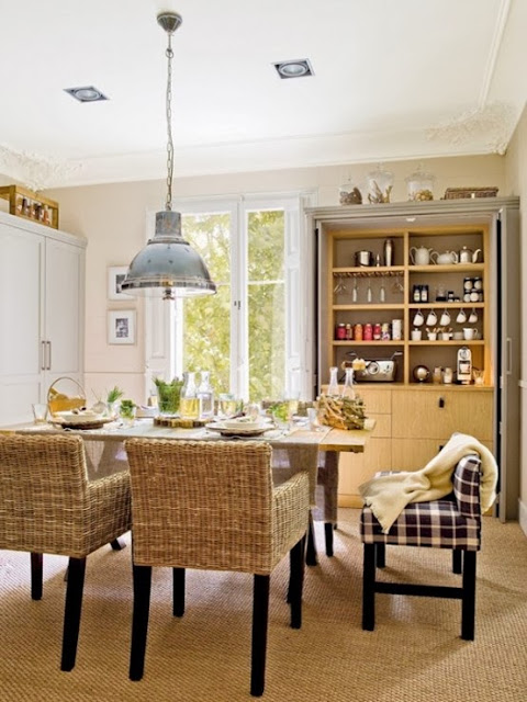 The wicker furniture and high stools, and also the floors bring coziness and comfort