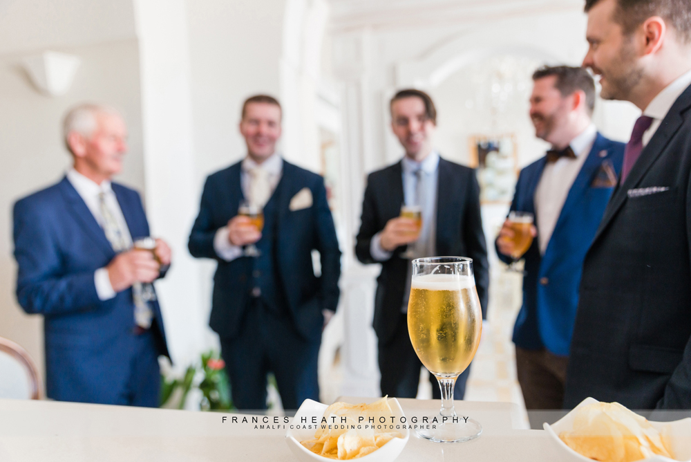 Groomsmen portrait having a beer before ceremony
