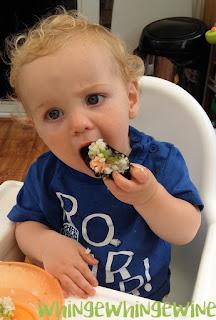 Baby eating sushi
