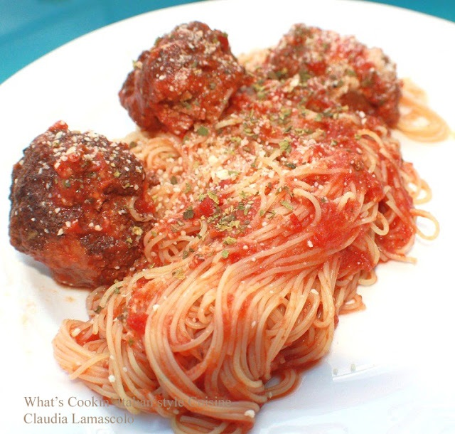this is a dish a macaroni made with plum fresh tomatoes with loads of grated  cheese, Italian meatballs and spaghetti with fresh sauce on top