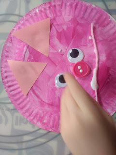 Preschooler finishing her easy pig craft