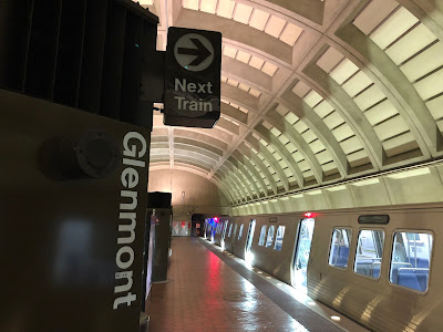 Photo of the platform of the Glenmont Metro Station with a train waiting.