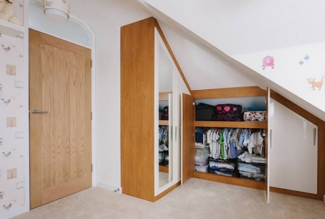 Custom Cupboard in the Nursery Under Attic Ceiling