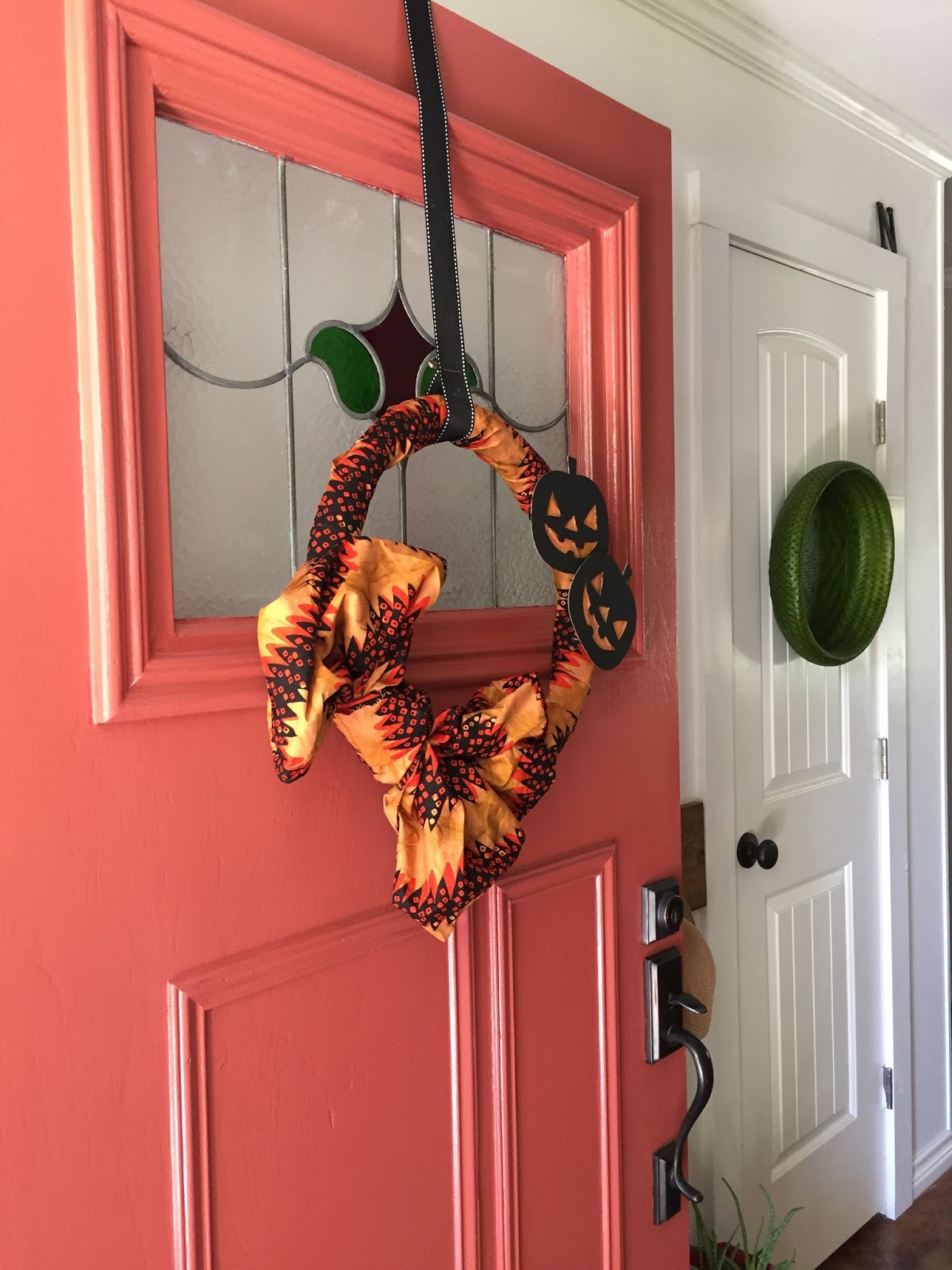 This quick and easy Halloween wreath is a cute addition to your fall decor. Hot glue, wreath form and fabric and you could have one for any holiday or season.