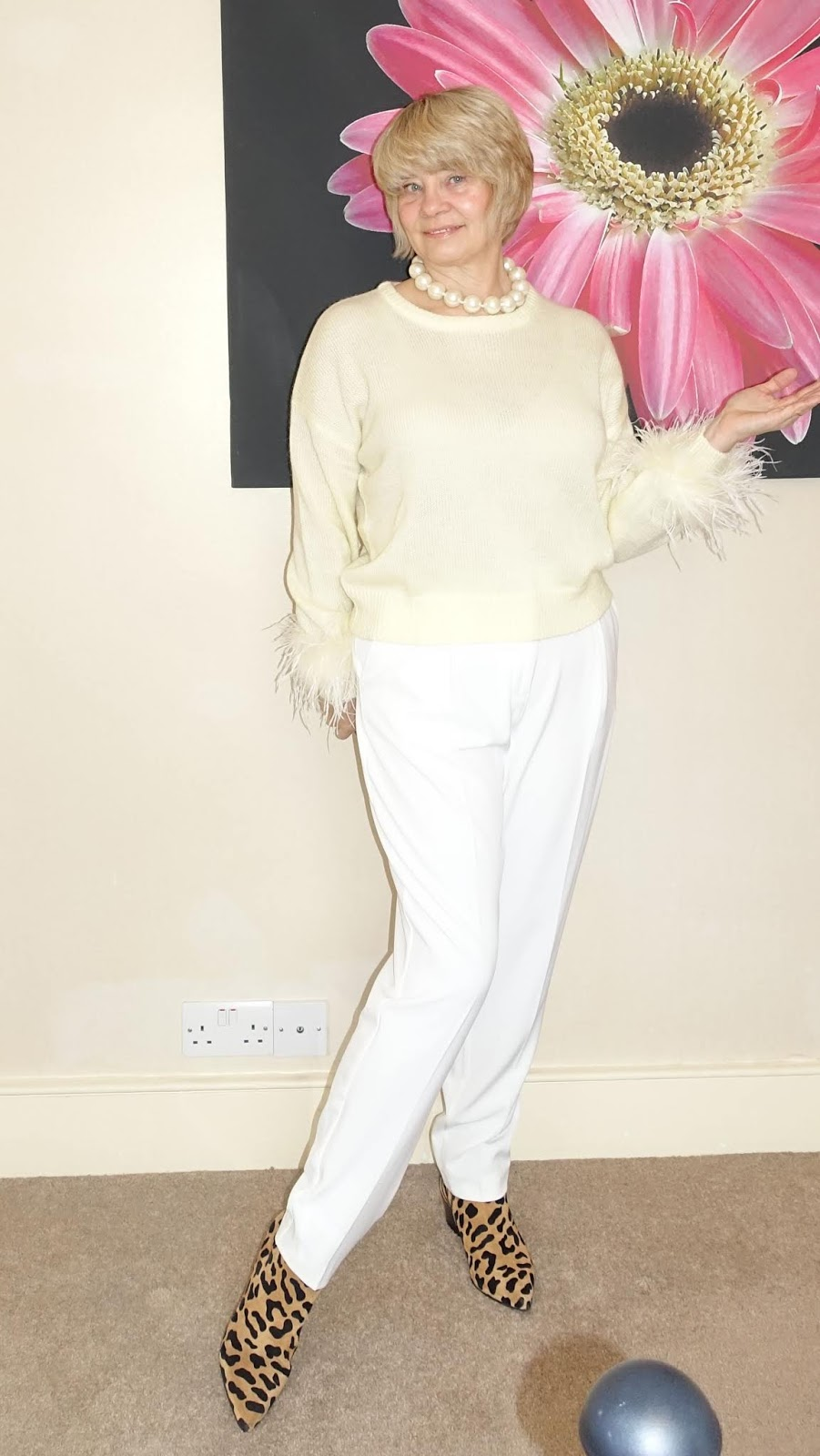 Over 50s blogger Gail Hanlon in lemon feather-trimmed jumper from Uterque and cream trousers
