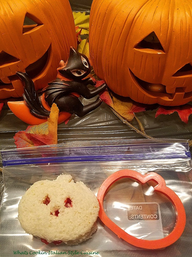 these are sandwiches made with white bread and cut using a cookie cutter into shapes for Halloween like pumpkins, bats,using any kind of cookie cutter and filled with peanut butter and jelly to look like blood