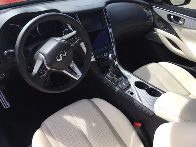 Interior view of 2017 Infiniti Q60 Red Sport 400