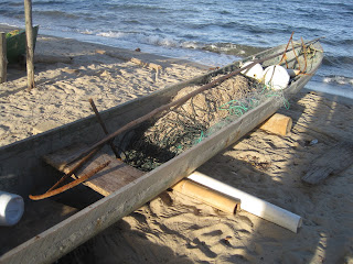 Belizean dugout canoe with fishing gear