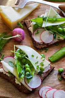English peas and Himalayan Yak Cheese with radishes on toast appetizer.