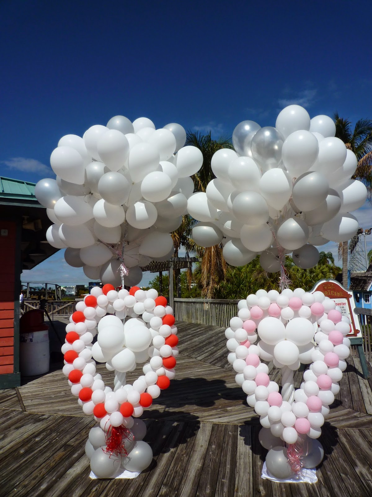Release heart balloon with helium balloons on wedding ceremony