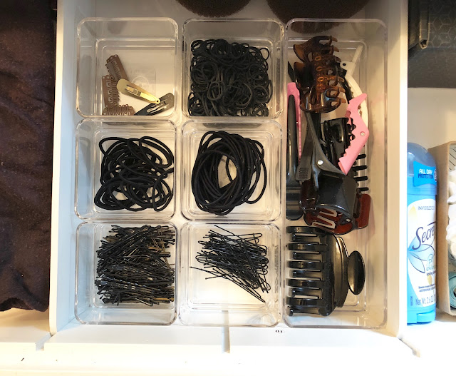 organized vanity drawer using container store bins