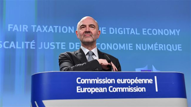 Image Attribute: European Commissioner for Economic and Financial Affairs, Taxation, and Customs Pierre Moscovici addresses a press conference at the European Union in Brussels on March 21, 2018. (AFP)