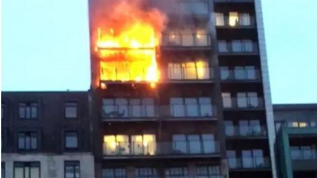 Fire takes over12-story apartment block in Manchester