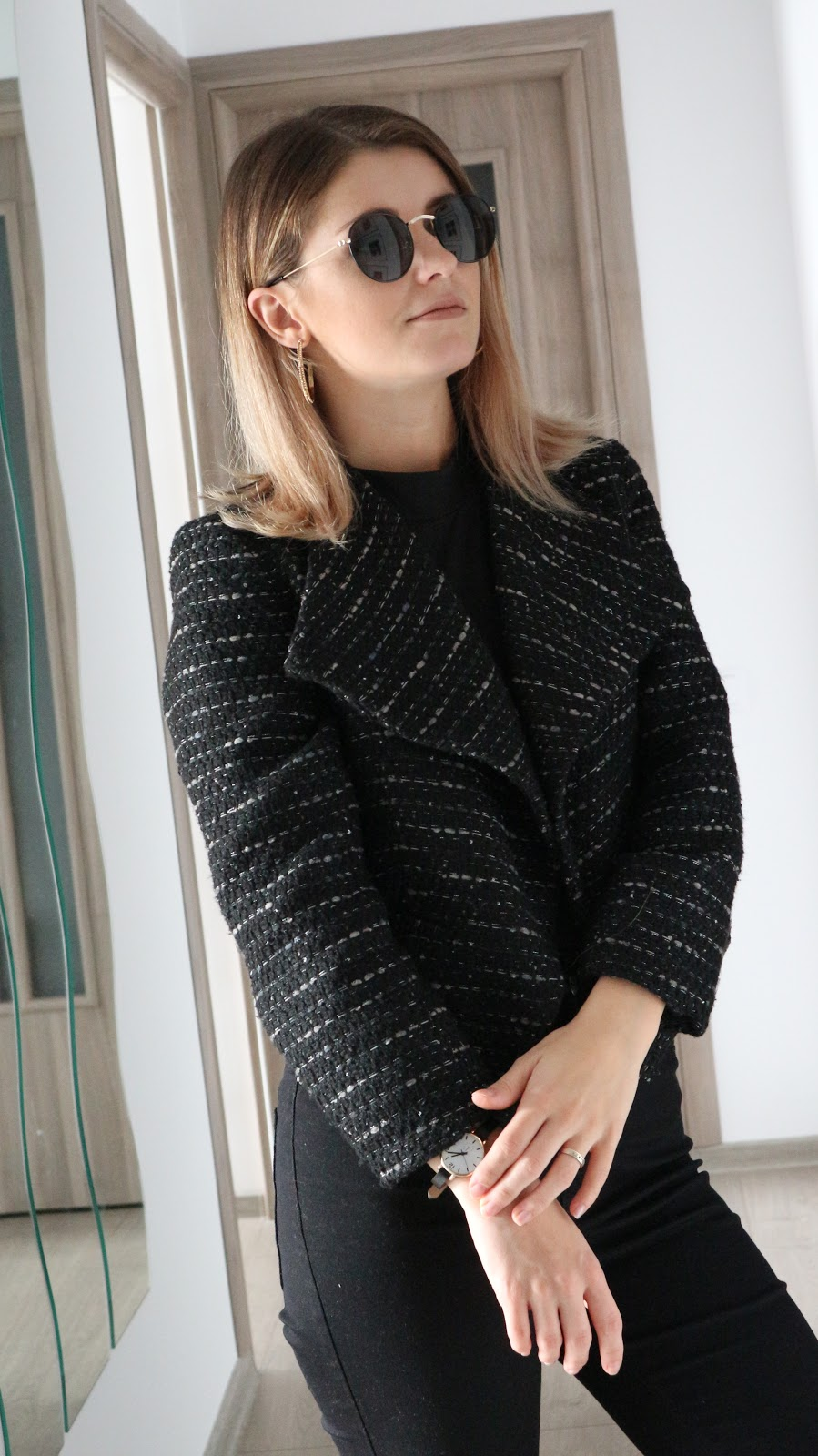 round black sunglasses and black tweed jacket outfit