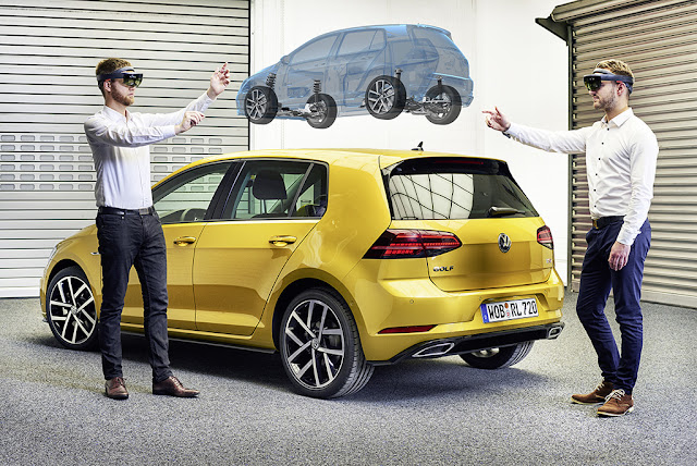 Image Attribute: Florian Uhde (left) and Christopher Krey (right) from the Virtual Engineering Lab of Volkswagen Group IT have a look at the chassis construction of the current Golf./ DB2017AL00223/ Source: Volkswagen AG