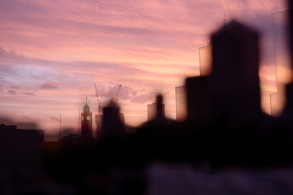 Cityscape with pink clouds and silhouette, taken from China Heights