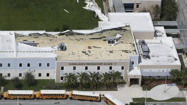 Part of the roof membrane atop the Everglades Preparatory Academy is peeled away in the wake of Hurricane Irma, Monday, Sept. 11, 2017, in Homestead, Fla. (AP Photo/Wilfredo Lee)