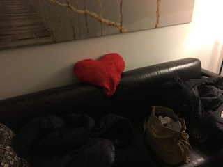 sofa with a heart shaped pillow