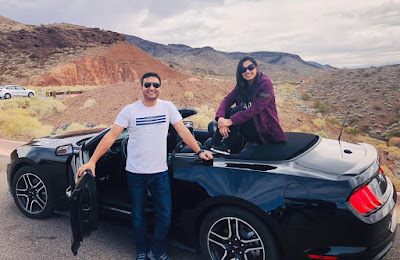 lalit shokeen with his wife neha on long drive in car