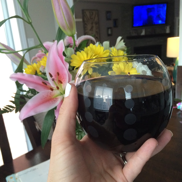 glass of wine and flowers