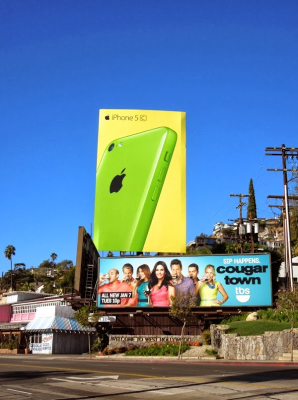 Giant green iPhone 5c wave 2 billboard Sunset Strip