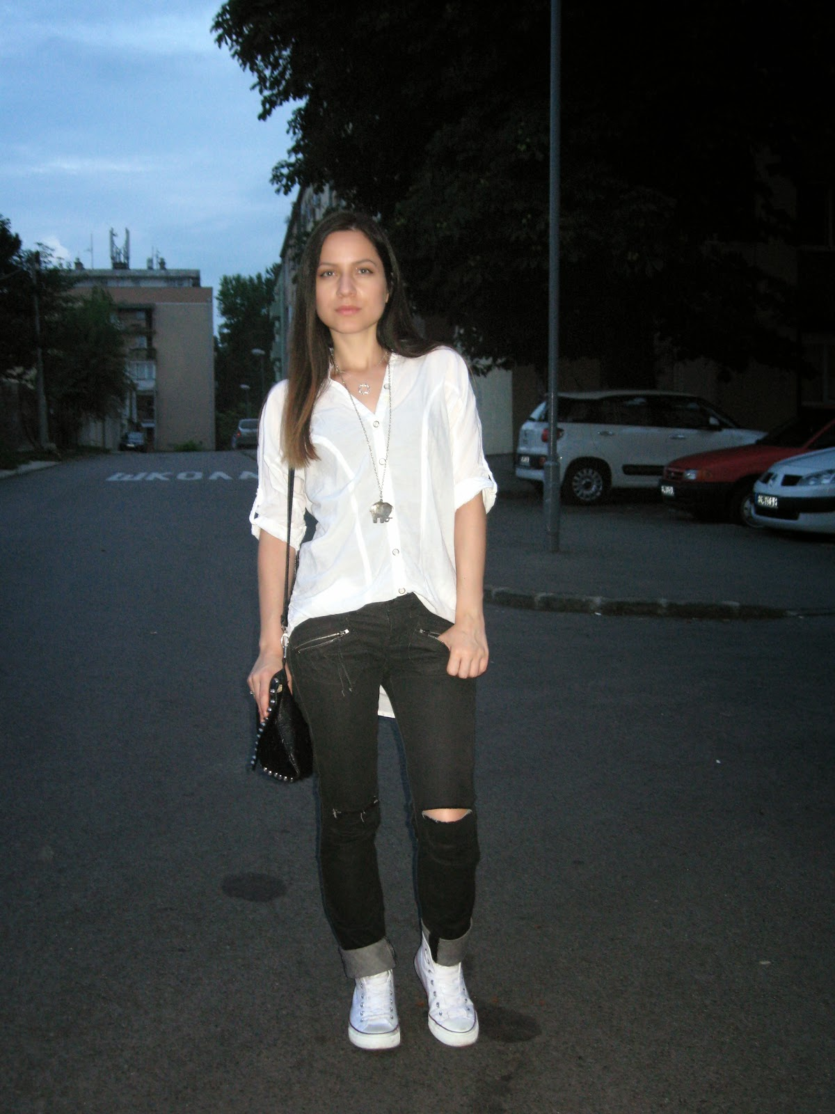 knee ripped black jeans, deichmann white sneakers, white t-shirt, black and white, black studded clutch, casual look