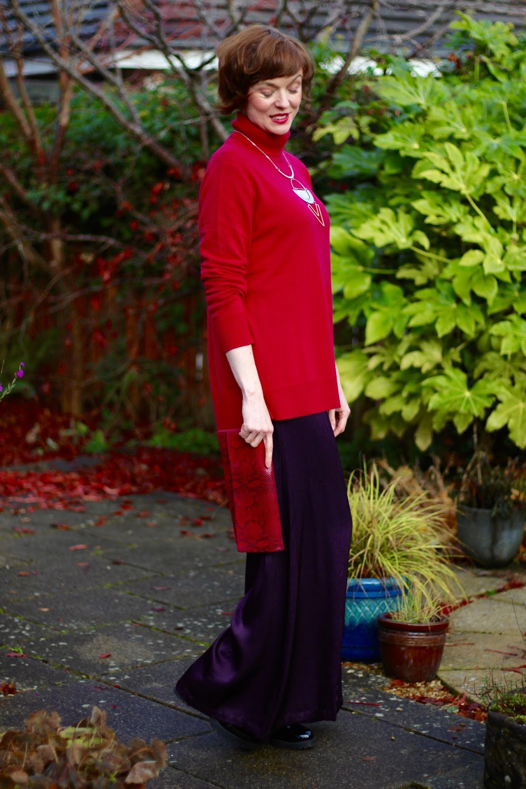 Woolovers Magenta Cashmere Jumper & purple satin trousers, over 40.