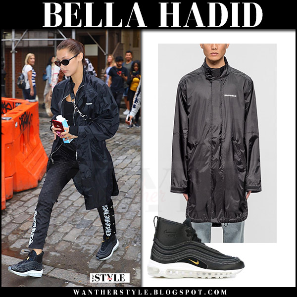 Bella Hadid in black rain jacket and black sweatpants streetstyle august 1 2017